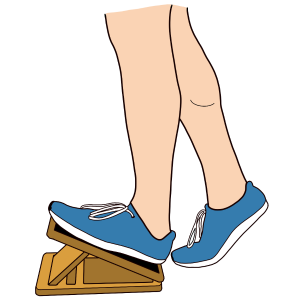 A person stretching their calves on a slant board