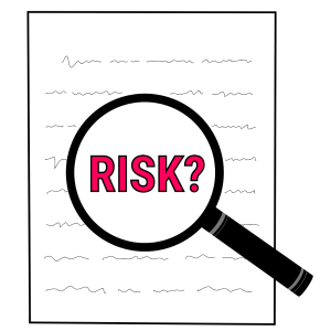 """A magnifying glass hovering over a sheet of paper with the word """"risk"""" in the middle."""